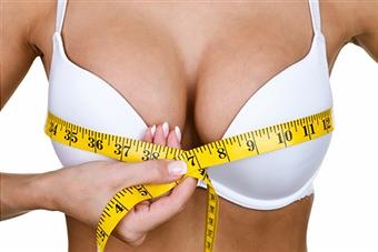 Girl in bikini top with large breasts