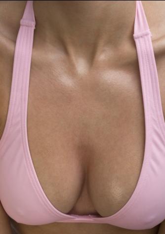 Woman showing off nice breast pink bikini top